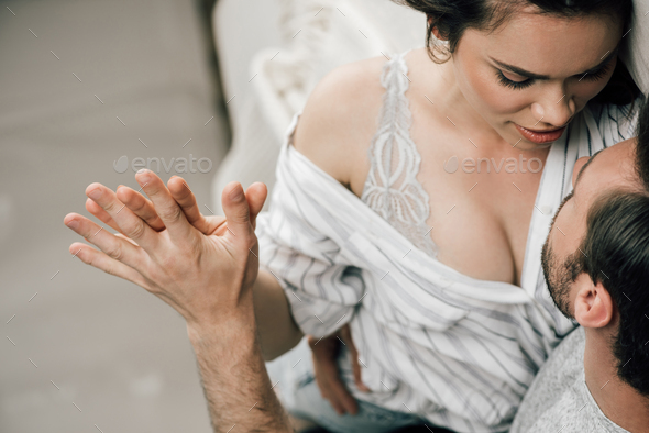 Cropped shot of passionate young couple holding hands in foreplay at home - Stock Photo - Images