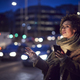 Woman On City Street At Night Ordering Taxi Using Mobile Phone App - PhotoDune Item for Sale