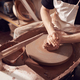Close Up Of Female Potter Shaping Clay For Pot On Pottery Wheel In Ceramics Studio - PhotoDune Item for Sale
