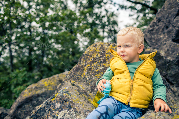 Little boy hiking in mountins - Stock Photo - Images