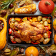 Roasted chicken or turkey garnished with pumpkins, pepper and potatoes. Served on a rustic table - PhotoDune Item for Sale