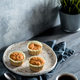 carrot muffins and coffee cup on gray wooden table - PhotoDune Item for Sale