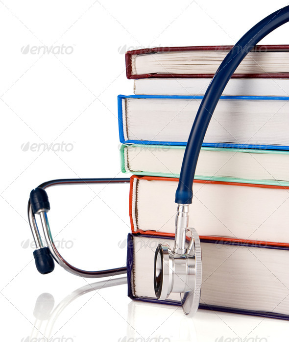 pile of old books and stethoscope isolated on white - Stock Photo - Images