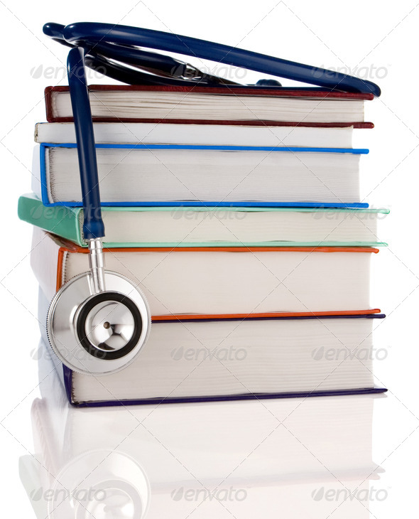 books and stethoscope isolated on white - Stock Photo - Images