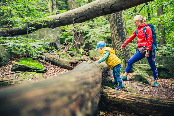 Young boy hiking with mother - Stock Photo - Images
