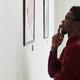 African-American Man Looking at Modern Art - PhotoDune Item for Sale