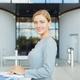 Portrait of Elegant Businesswoman Looking at Camera during Coffee Break - PhotoDune Item for Sale