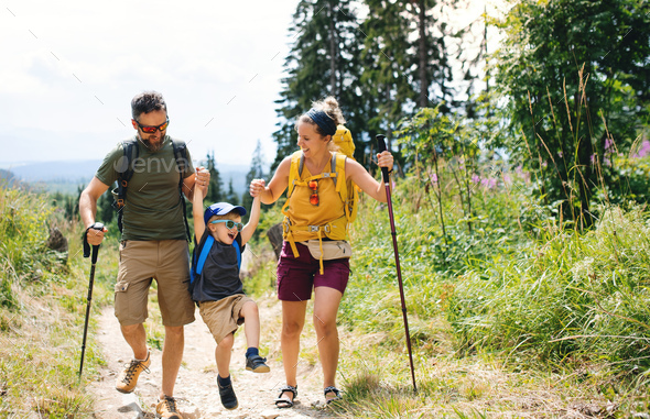 Family with small son hiking outdoors in summer nature - Stock Photo - Images