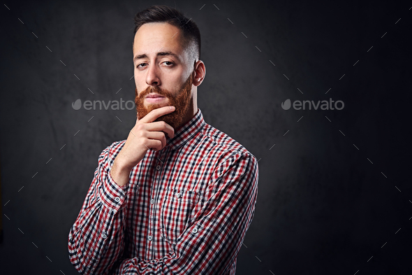 Thoughtful redhead bearded hipster male. - Stock Photo - Images