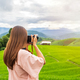 Young woman traveler on vacation taking a picture at beautiful green rice terraces field - PhotoDune Item for Sale