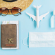 Sergical mask with travel items and passport, Travelling during corona virus epidemic concept - PhotoDune Item for Sale