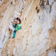 Woman climbing challenging route on overhanging cliff - PhotoDune Item for Sale