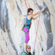Female rock climber standing on shoulders of her partner - PhotoDune Item for Sale