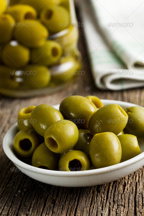 green olives on kitchen table - Stock Photo - Images