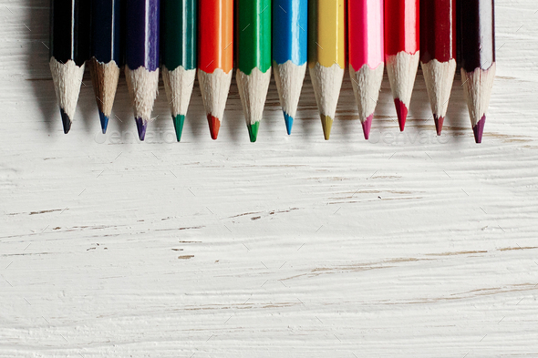 colorful pencils on white rustic wooden background - Stock Photo - Images