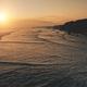 Ocean seascape at sunset light, cliff coast silhouette aerial view. Dark rock sea shore, sand beach - PhotoDune Item for Sale