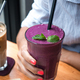 Young lady drinking a colorful purple healthy smoothie - PhotoDune Item for Sale