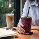 Young lady enjoying her drinks while journaling in a coffee shop - PhotoDune Item for Sale