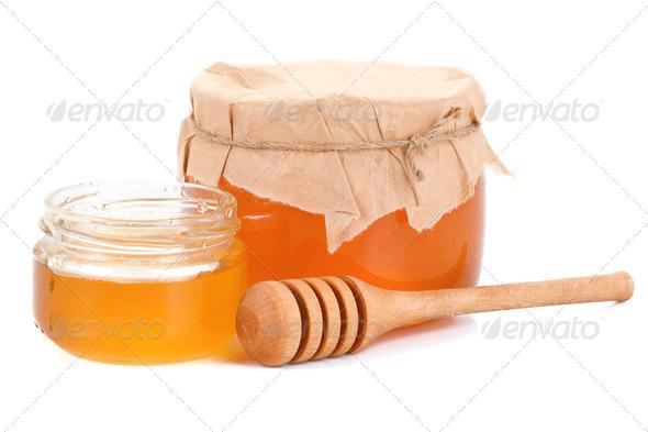 glass pot full of honey isolated on white - Stock Photo - Images