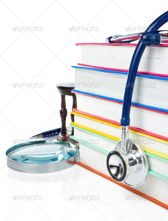 pile of books, pen and stethoscope isolated on white - Stock Photo - Images