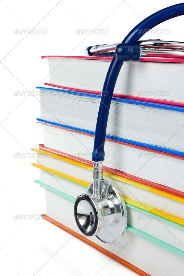 pile of books and stethoscope isolated on white - Stock Photo - Images