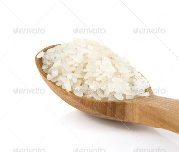 rice in wooden spoon isolated on white - Stock Photo - Images