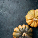 Organic pumpkin on dark background. Top view. Flat lay. Copy space for advertising. Fall harvest - PhotoDune Item for Sale