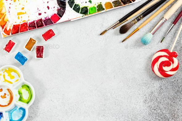 Artist workspace on gray stone background. - Stock Photo - Images