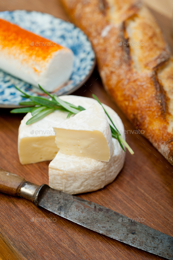 French cheese and fresh  baguette on a wood cutter - Stock Photo - Images