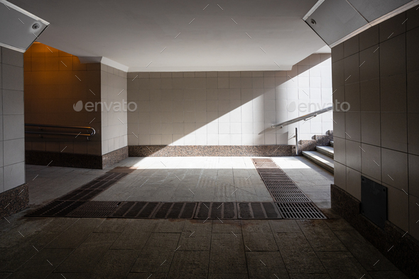 Underground passage lit by the sun - Stock Photo - Images