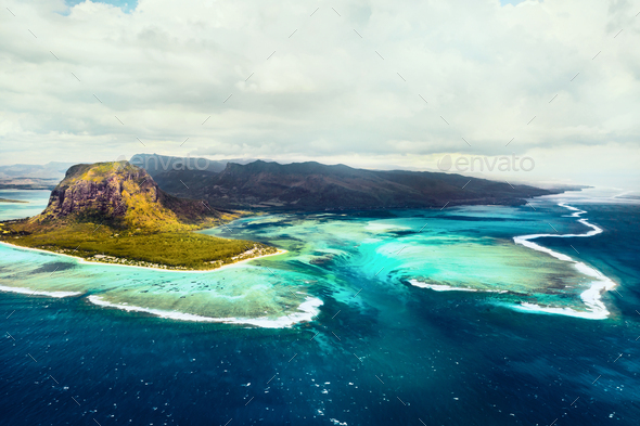 A bird's-eye view of Le Morne Brabant, a UNESCO world heritage site.Coral reef of the island of - Stock Photo - Images