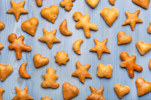 Gingerbread cookies on blue background - Stock Photo - Images