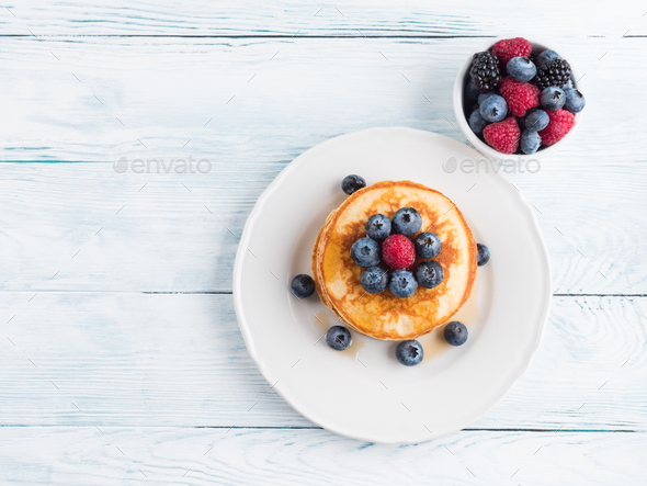 Stack of pancakes with blueberries and syrup - Stock Photo - Images