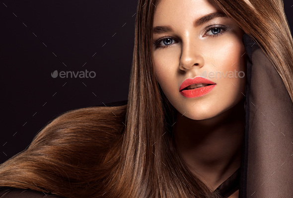 Woman with beauty long brown hair. Beauty woman with living coral color lipstick on lips. - Stock Photo - Images