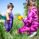 Girl sitting on grass and giving dandelion flowers to small boy - PhotoDune Item for Sale