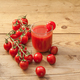 A glass full of tomato juice surrounded by freshly picked tomatoes - PhotoDune Item for Sale