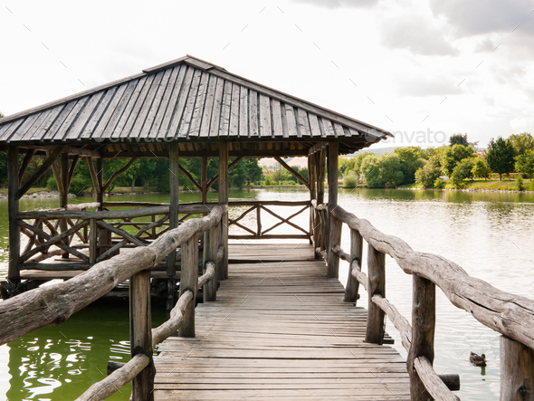 Wooden shelter on a quiet lake - Stock Photo - Images