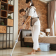 Portrait of a woman carries her baby mopping bedroom floor - PhotoDune Item for Sale