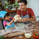 cute little daughter with handsome father cooking pastry - PhotoDune Item for Sale