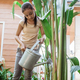 a beautiful young girl was planting and watering crops - PhotoDune Item for Sale
