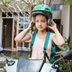 Beautiful young girl is sitting on his motorcycle wearing tshirt bag and helmet - PhotoDune Item for Sale
