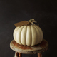 White pumpkin on old stool - PhotoDune Item for Sale
