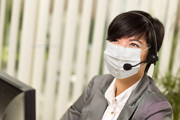 Woman At Office Desk Wearing Medical Face Mask - Stock Photo - Images
