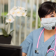 Nurse At Office Desk Wearing Medical Face Mask - PhotoDune Item for Sale