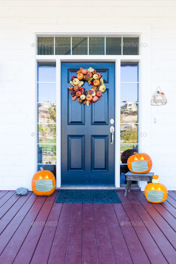 Beautiful House Porch Decorated For Halloween with Pumpkins Wearing Medical Face Masks - Stock Photo - Images