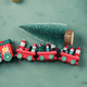 Christmas festive green background with toy train - PhotoDune Item for Sale