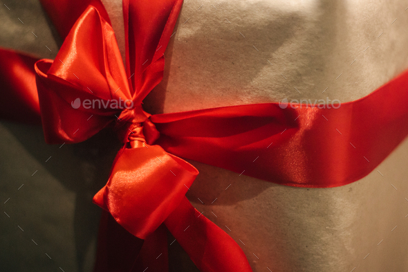 stylish craft gift boxes with red ribbons in window shop, seasonal holiday present concept - Stock Photo - Images