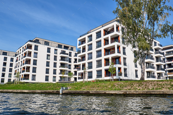 Modern apartment buildings at the river Spree - Stock Photo - Images