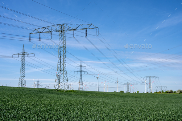 Power lines with wind turbines - Stock Photo - Images