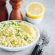 Lemon Herb Couscous in bowl on gray background - PhotoDune Item for Sale